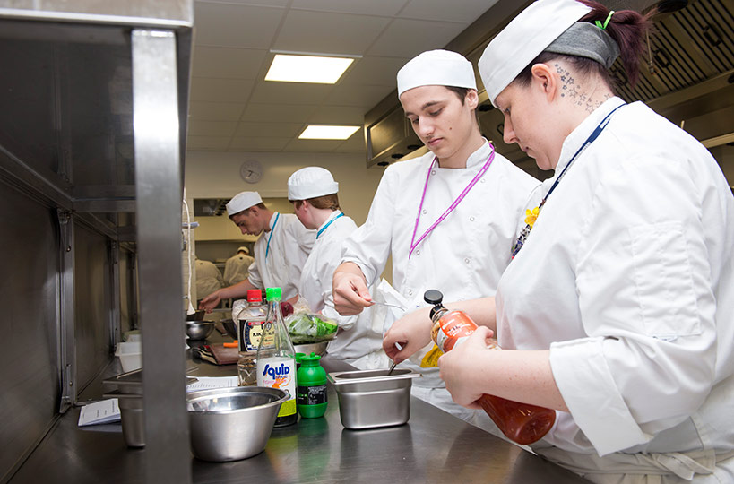 Industry-standard kitchens allow hospitality and cookery students to perfect their culinary skills.