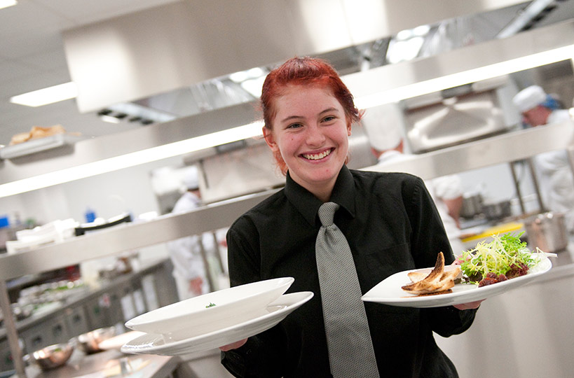Service with a smile – students have the opportunity to showcase their skills.