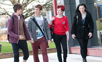 photo of four student walking