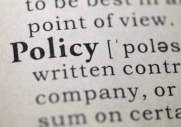 Image of a closeup of the word policy in a dictionary