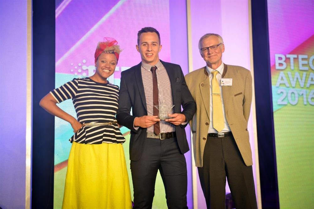 Sam with host Gemma Cairney from Radio 1 and Ralph Saelzer, managing director of Liebherr
