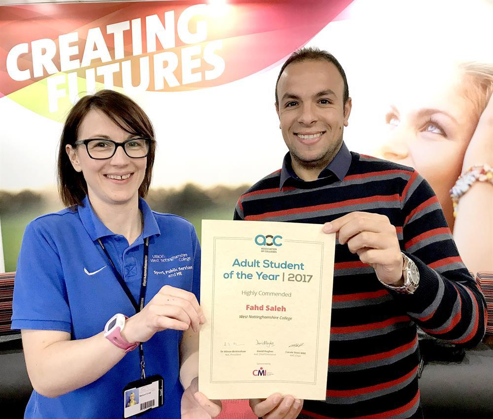 Fahd receives his certificate from tutor Rachael.