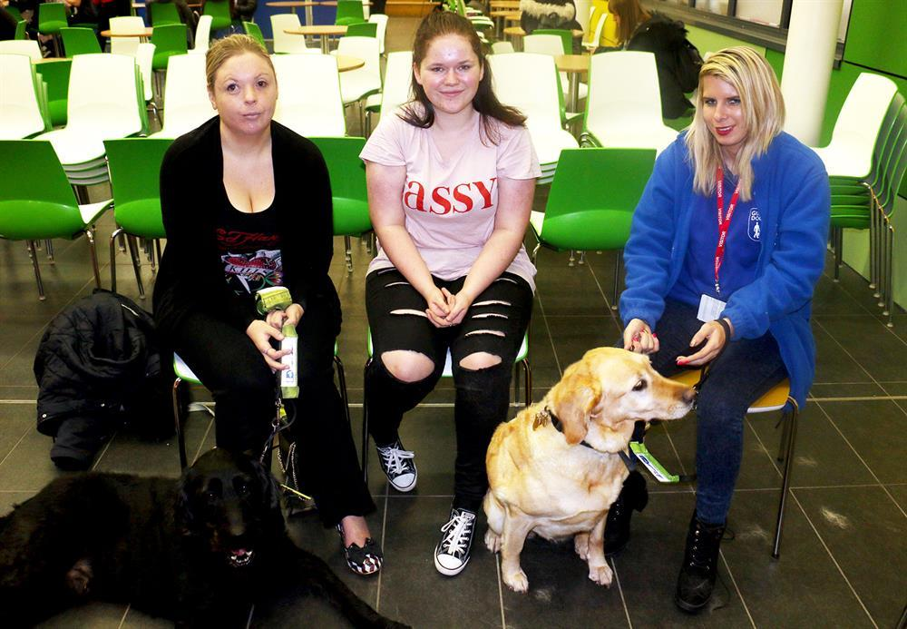 Kimberley Jones with Darby, student Lolita Ancliffe and Jasmin Newton with Jingle